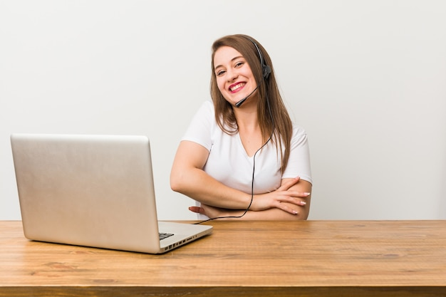 Young telemarketer woman laughing and having fun.