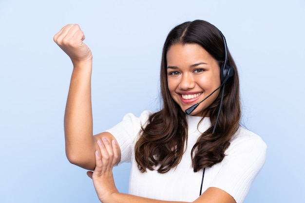 Young telemarketer woman making strong gesture