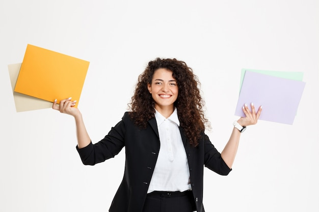 Young tender curly girl holding documents