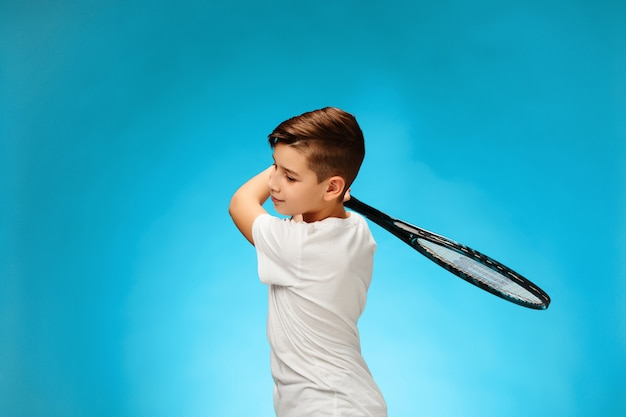 Young tennis player on blue space.