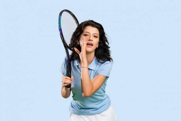 Young tennis player woman whispering something
