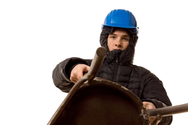 Young thug in a hoodie and hardhat using a wooden chair as a weapon