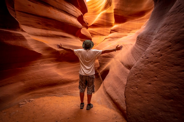 A young tourist admiring the beauty of lower antelope