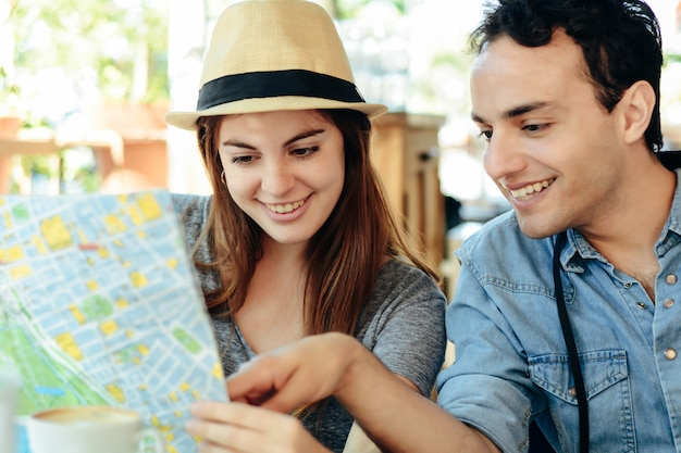 Young tourist couple are looking at a map