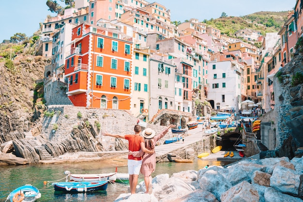 Young tourist couple traveling on european holidays outdoors in italian vacation in cinque terre