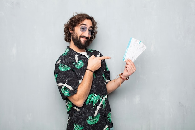 Young tourist man with boarding pass tickets