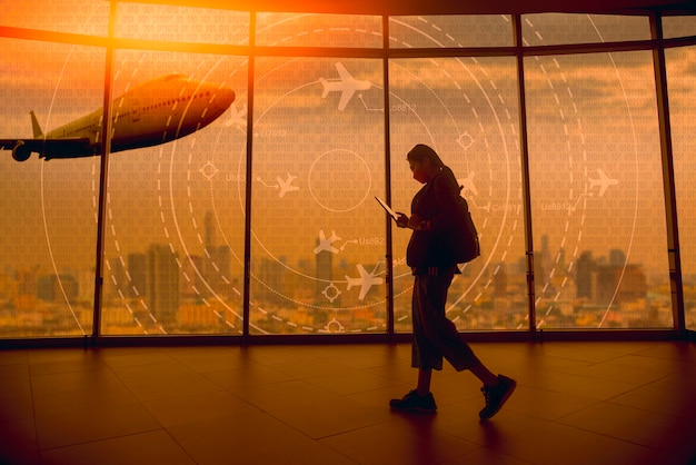 A young tourist walks past a simulated screen showing various flights for transport and passengers