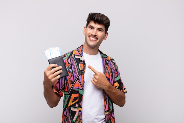 Young tourist with a passport smiling cheerfully