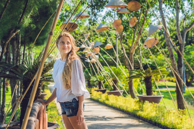 Young tourist woman. travel around vietnam concept