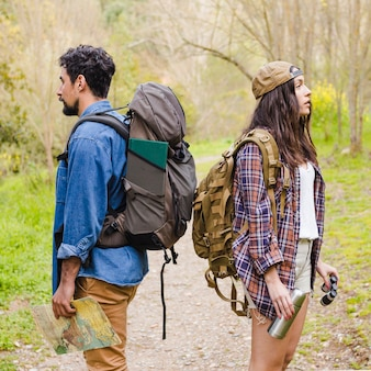 Young tourists in forest