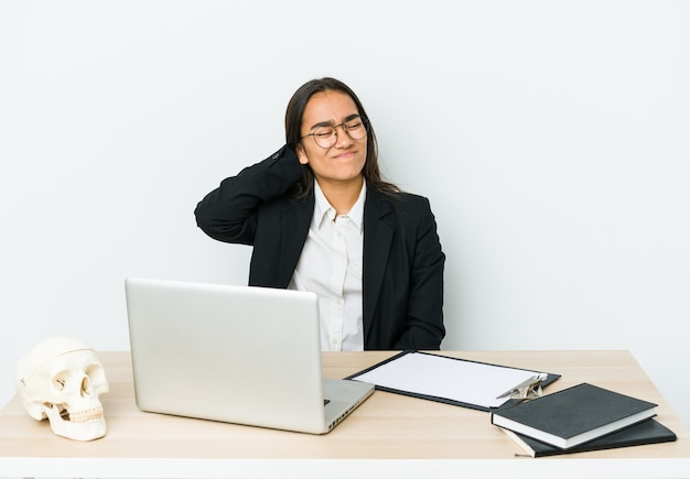 Young traumatologist asian woman suffering neck pain due to sedentary lifestyle.