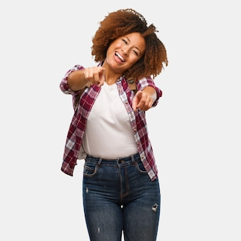 Young traveler black woman cheerful and smiling