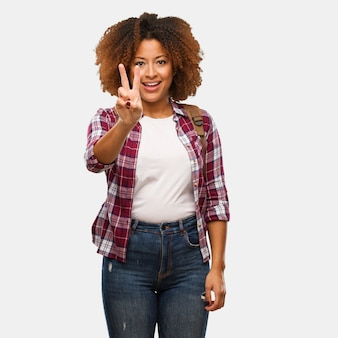 Young traveler black woman showing number two