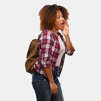 Young traveler black woman whispering gossip undertone