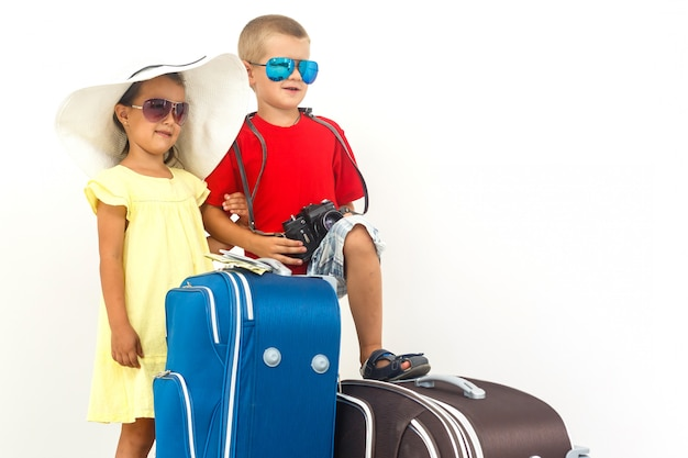 The young traveler kids with a suitcase