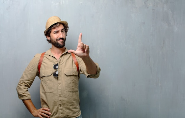 Young traveler man or tourist gesturing