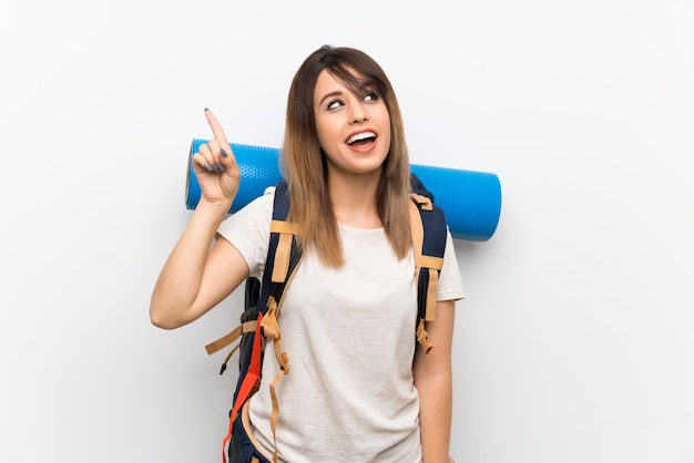 Young traveler woman intending to realizes the solution while lifting a finger up