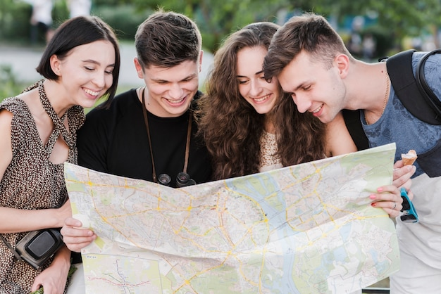 Young travelers exploring city map