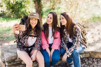 Young travellers taking selfie