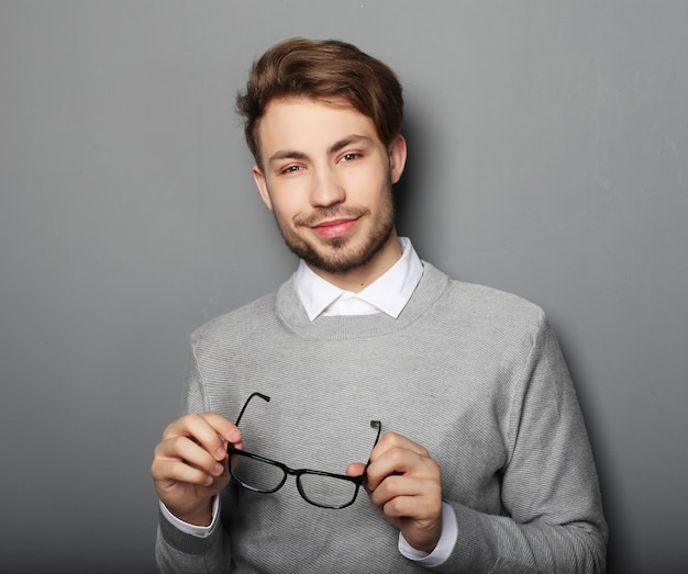 Young  trendy man with glasses smiling