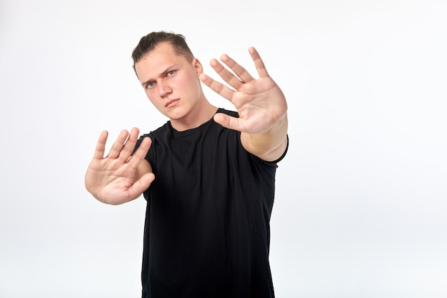 Young unhappy scared man showing gesture of denial