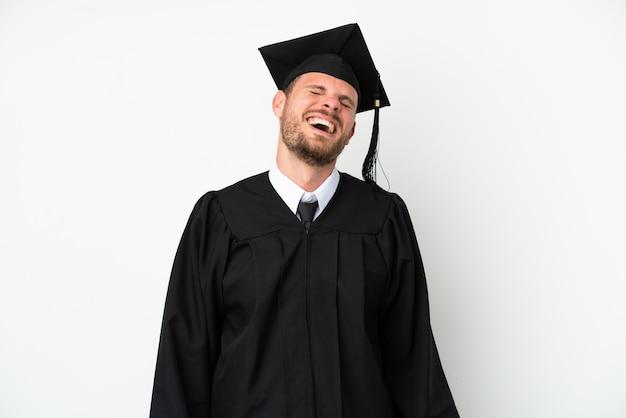 笑って白い背景で隔離の若い大学ブラジル卒業生