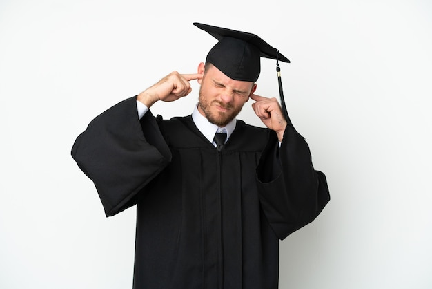 Young university brazilian graduate isolated on white background frustrated and covering ears