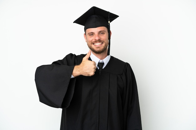 Young university brazilian graduate isolated on white background giving a thumbs up gesture