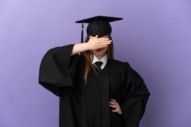 Young university graduate over isolated purple background covering eyes by hands. do not want to see something