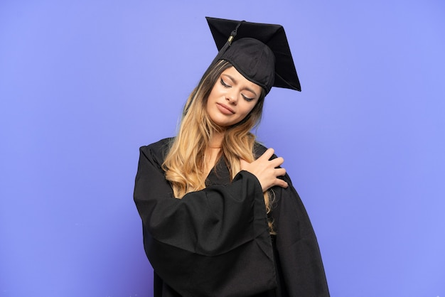 Young university graduate russian girl isolated on white background suffering from pain in shoulder for having made an effort