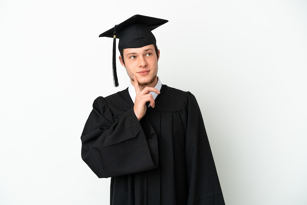 Young university russian graduate isolated on white background thinking an idea while looking up