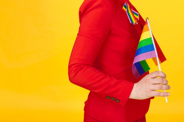 Young unrecognizable woman  holding small lgbt flag