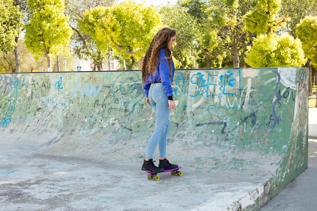 Young urban woman skating