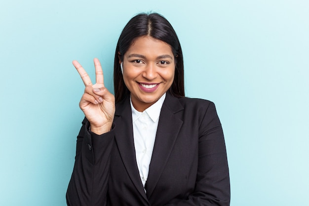 Young venezuelan business woman isolated on blue background showing number two with fingers.