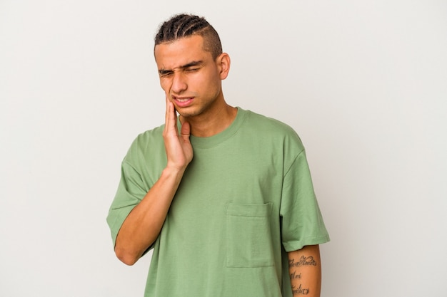 Young venezuelan man isolated on white background having a strong teeth pain, molar ache.