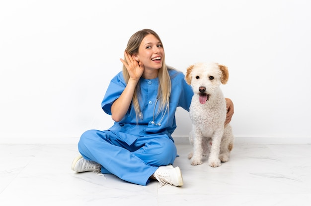Young veterinarian woman with dog