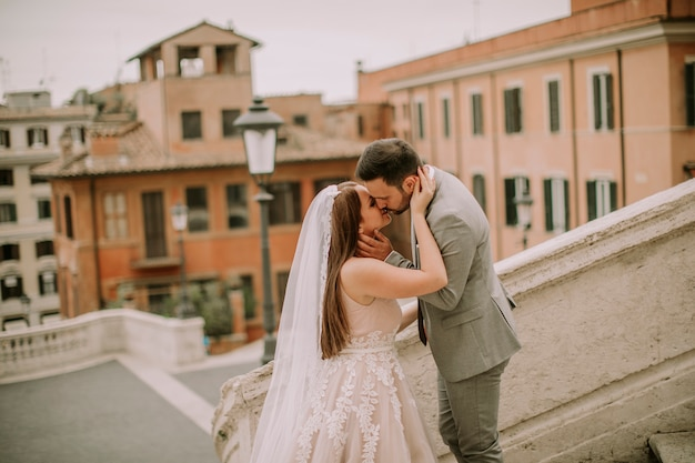 Young wedding couple on spanish stairs in rome, italy