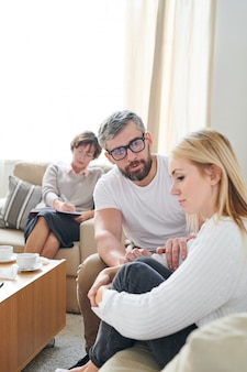 Young wife feeling sorrow at therapy session