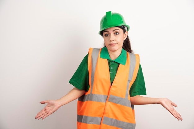 Young woman architect in uniform and helmet. high quality photo