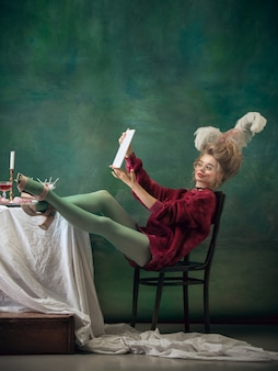 Young woman as marie antoinette on dark.