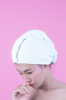 Young woman asia with clean fresh skin touch own face, expressive facial expressions, cosmetology and spa.