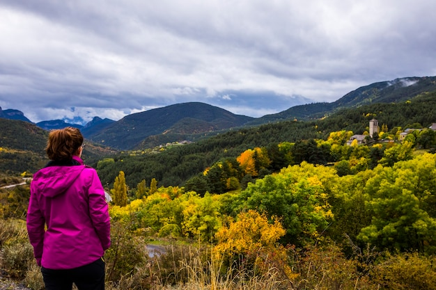 Young woman in autumn in ordesa and monte perdido national park, spain