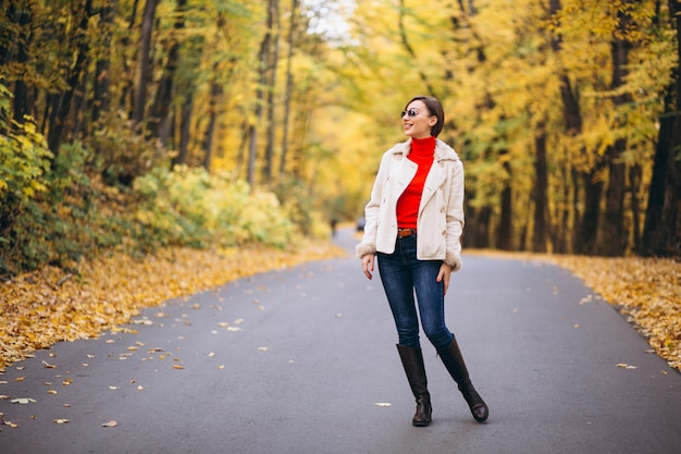Young woman in an autumn park