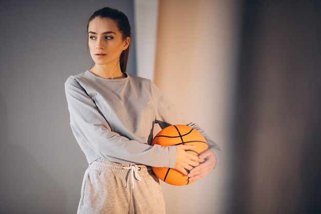 Young woman basketball player isolated
