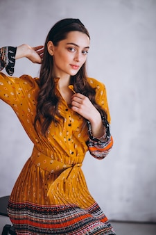 Young woman in a beautiful yellow dress