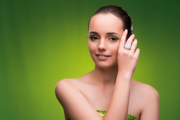 Young woman in beauty concept on green