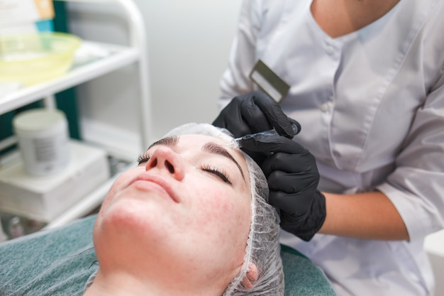 Young woman in a beauty salon. beauty facial injections.cosmetology concept.