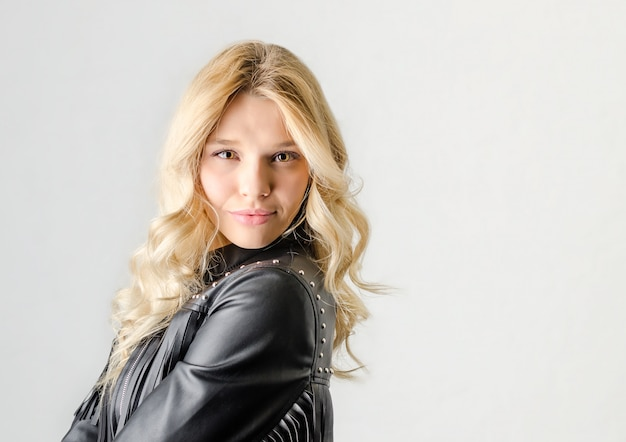 Portrait of a sexy girl with naked legs and in leather jacket posing