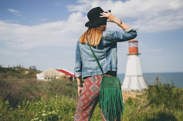 Young woman in bohemian style in the countryside
