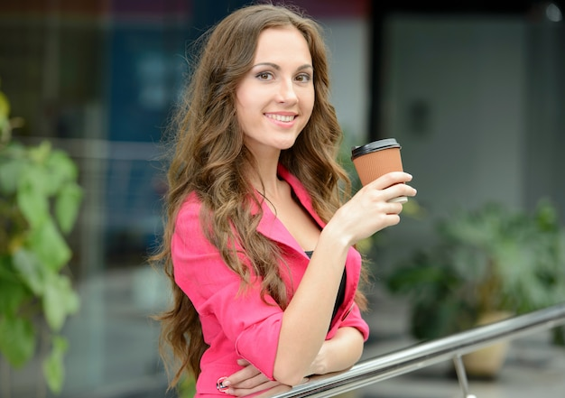 Young woman business is drinking coffee.